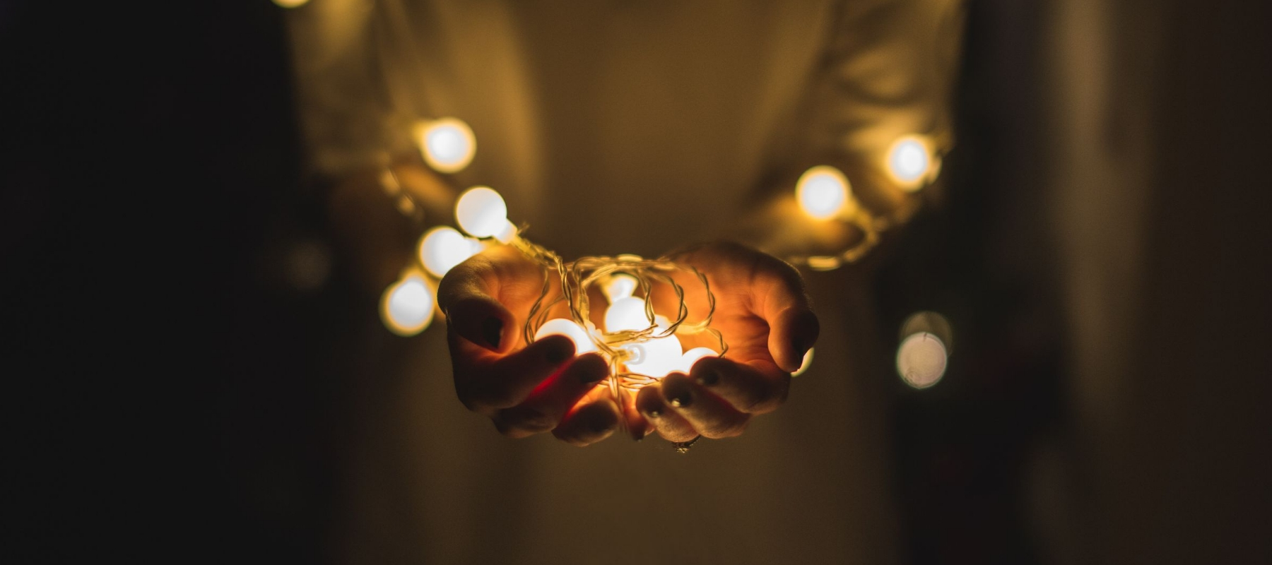 Heroic Fundraising Featured Image_Hands Glowing in Light