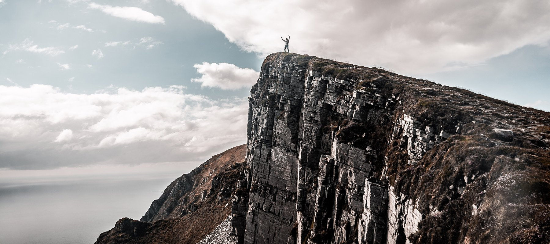 Heroic Fundraising Featured Image_A Person Standing on Top of a Mountain