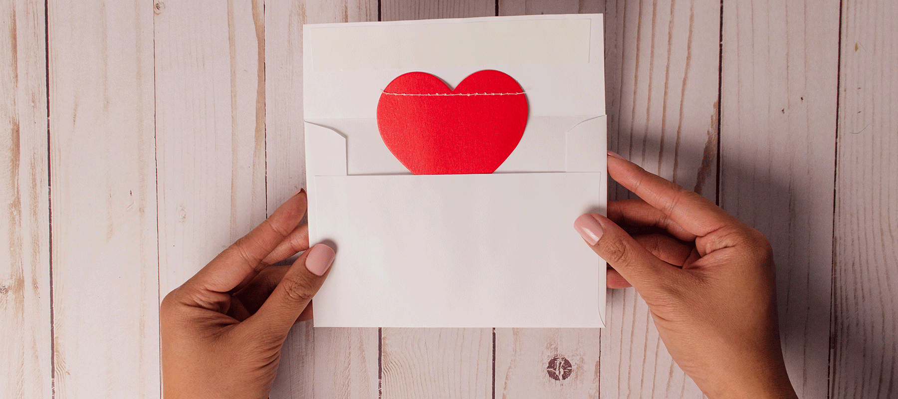 heroic-fundraising-featured-image_-hand-hearts-envelope