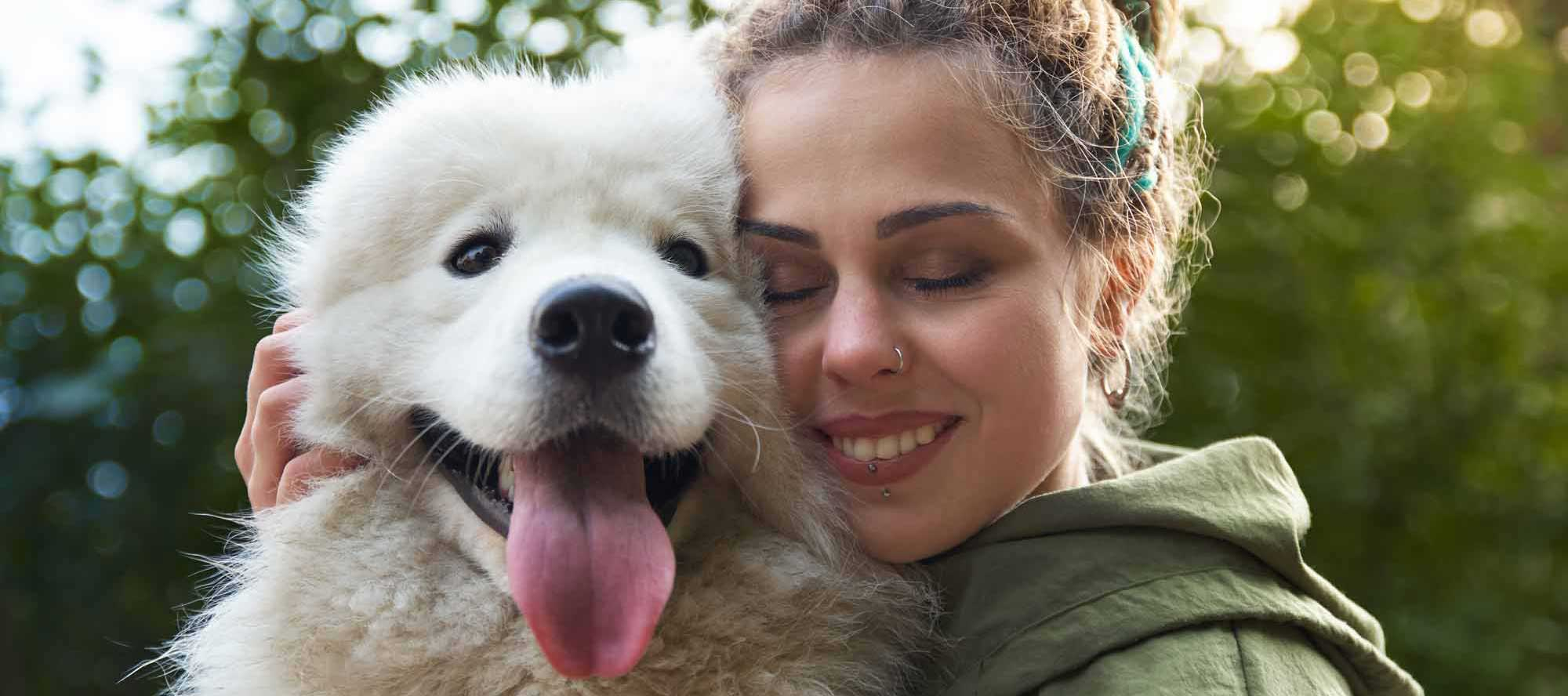 woman-with-adopted-pet-heroic-fundraising