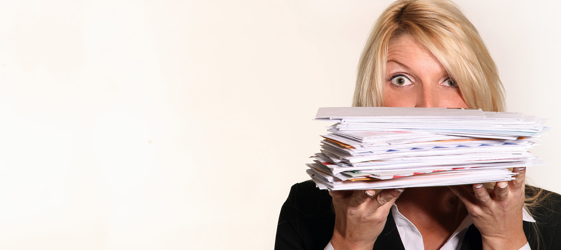 Heroic Fundraising Featured Image_Woman Holding a Large Stack of Mail